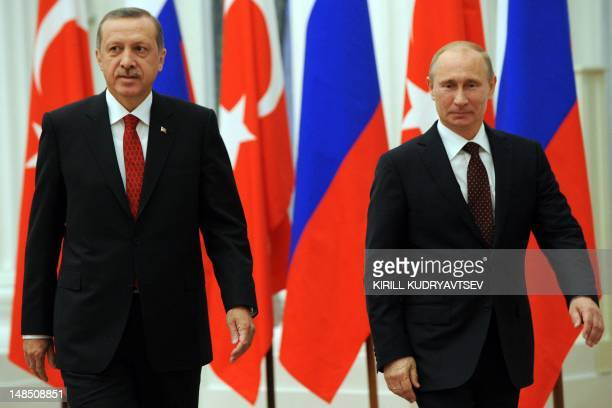 Russian President Vladimir Putin and Turkish Prime Minister Recep Tayyip Erdogan attend on a press conference after their meeting to discuss...