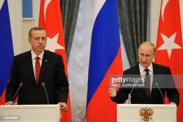 Russian President Vladimir Putin and Turkish Prime Minister Recep Tayyip Erdogan speak during a press conference after their meeting to discuss...