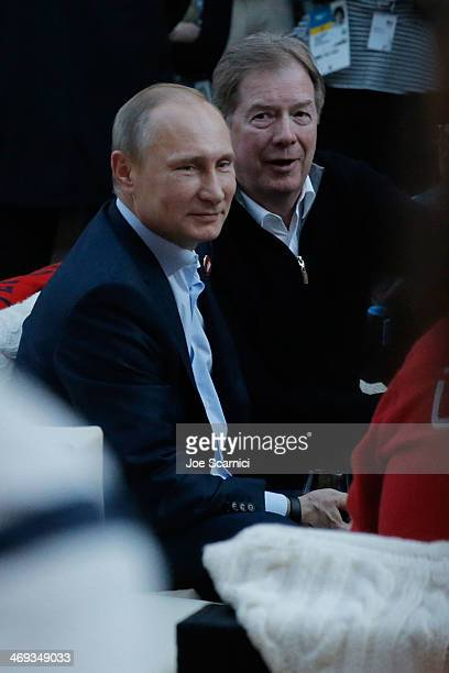 Russian President Vladimir Putin and US Olympic Committee chairman Larry Probst visit USA House in the Olympic Village on February 14 2014 in Sochi...