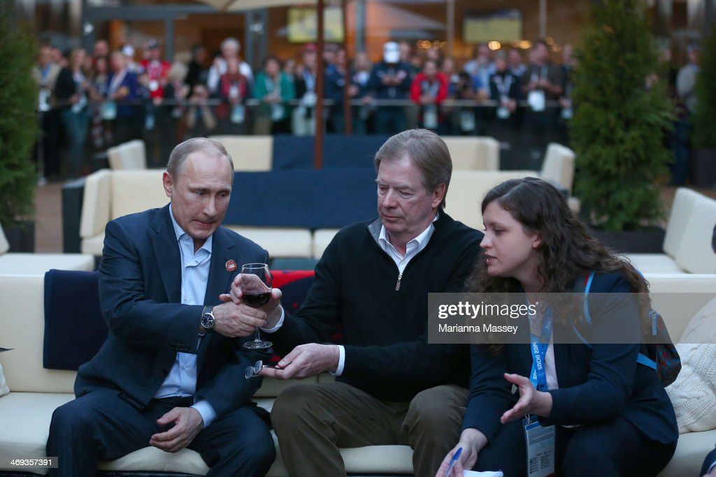 Russian President Vladimir Putin and U.S. Olympic Committee chairman Larry Probst visit USA House in the Olympic Village on February 14, 2014 in Sochi, Russia.