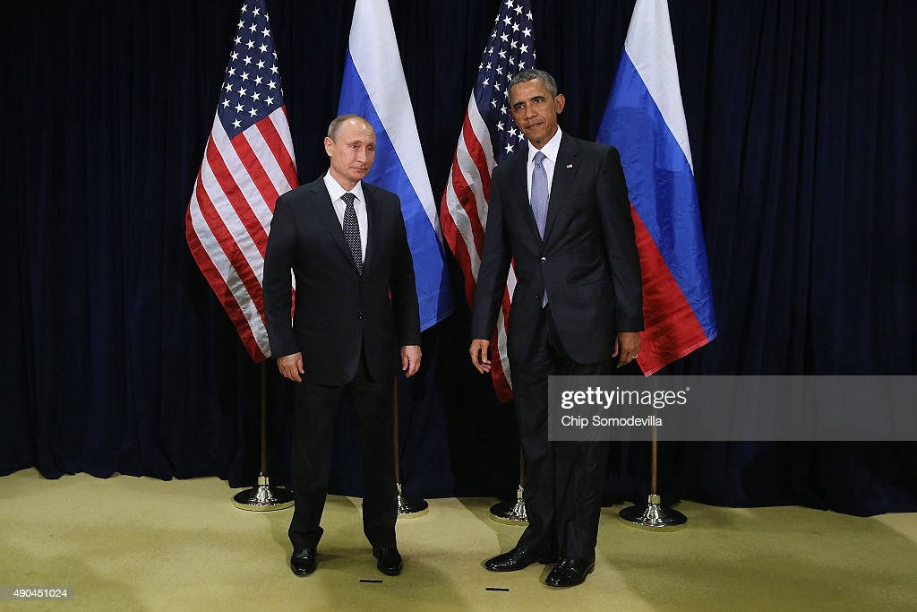 Russian President Vladimir Putin and U.S. President Barack Obama pose for photographs before the start of a bilateral meeting at the United Nations headquarters September 28, 2015 in New York City. Putin and Obama are in New York City to attend the 70th anniversary general assembly meetings.