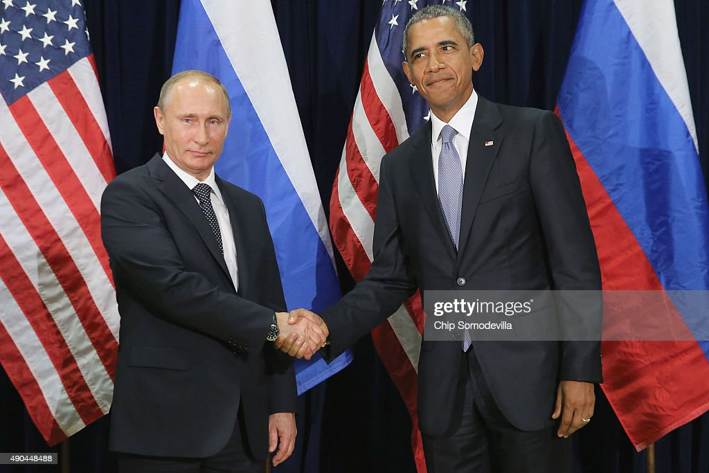 Russian President Vladimir Putin (L) and U.S. President Barack Obama shake hands for the cameras before the start of a bilateral meeting at the United Nations headquarters September 28, 2015 in New York City. Putin and Obama are in New York City to attend the 70th anniversary general assembly meetings.