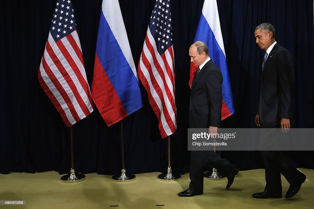 Russian President Vladimir Putin (L) and U.S. President Barack Obama walk out for a photo-op before the start of a bilateral meeting at the United Nations headquarters September 28, 2015 in New York City. Putin and Obama are in New York City to attend the 70th anniversary general assembly meetings.