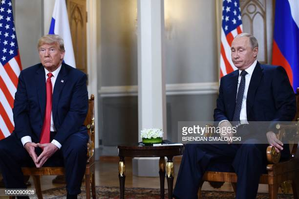 TOPSHOT Russian President Vladimir Putin and US President Donald Trump attend a meeting in Helsinki on July 16 2018