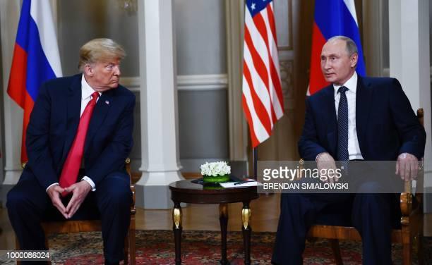 Russian President Vladimir Putin and US President Donald Trump pose ahead a meeting in Helsinki on July 16 2018
