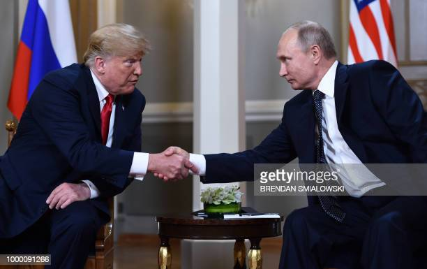 TOPSHOT Russian President Vladimir Putin and US President Donald Trump shake hands before a meeting in Helsinki on July 16 2018