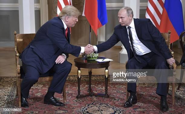 Russian President Vladimir Putin and US President Donald Trump shake hands ahead of their bilateral summit in Helsinki Finland on July 16 2018