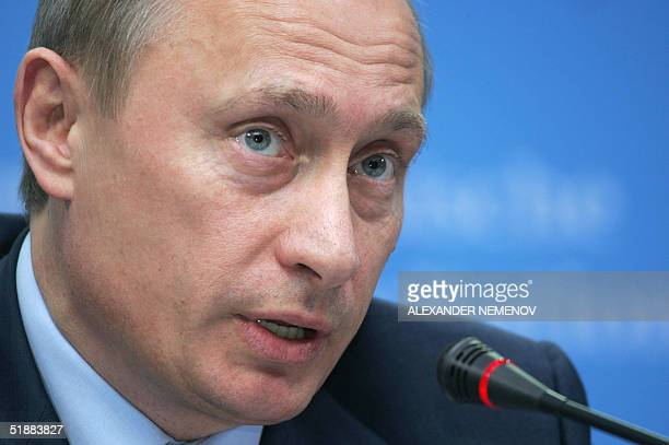 Russian President Vladimir Putin answers journalists' questions during his joint press conference with German Chancellor Gerhard Schroeder at Gottorf...