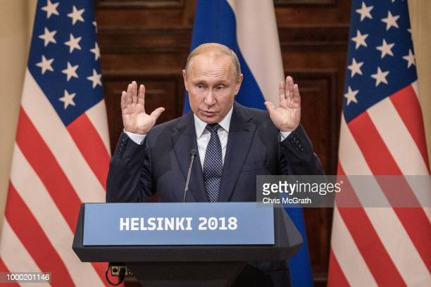 Russian President Vladimir Putin answers questions about the 2016 US Election collusion during a joint press conference with US President Donald...