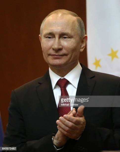 Russian President Vladimir Putin applauds during RussianTajik talks on February 27 2017 in DushanbeTajikistan Putin is having a two day visit to...