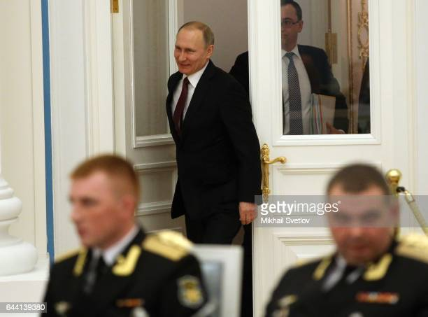 Russian President Vladimir Putin arrives for a meeting with naval officers and jet and bomber pilots who took part in the military operation in Syria...