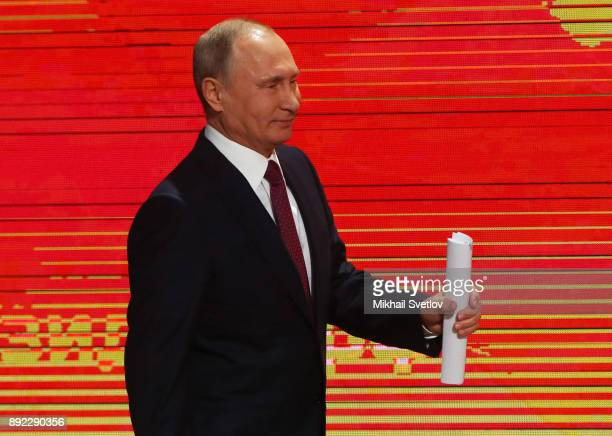Russian President Vladimir Putin arrives for his annual press conference on December 14 2017 in Moscow Russia