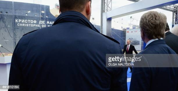 Russian President Vladimir Putin arrives for the naming ceremony of the new Russian 'Christophe de Margerie' Arctic LNG tanker on the side of the...