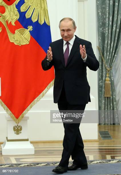 Russian President Vladimir Putin arrives to an awards ceremony at the Kremlin on May 24 2017 in Moscow Russia President Vladimir Putin has awarded...