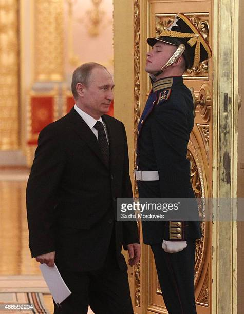 Russian President Vladimir Putin arrives to attend a meeting of the Russian Pobeda Organizing Committee in the Grand Kremlin Palace on March 17 2015...