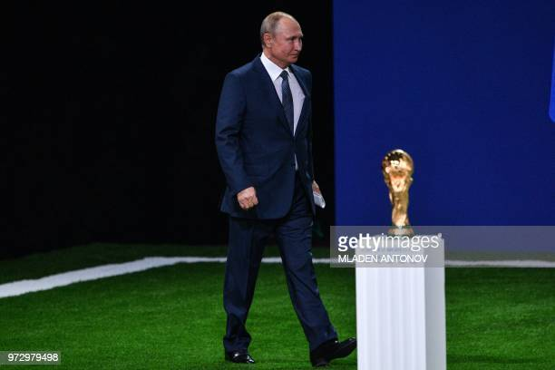 Russian President Vladimir Putin arrives to give a speech during the 68th FIFA Congress at the Expocentre in Moscow on June 13 2018