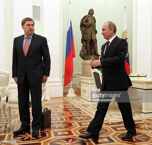 Russian President Vladimir Putin arrives to meet Israeli Prime Minister Benjamin Netanyahu as his advisor Yuri Ushakov looks on during the Security...