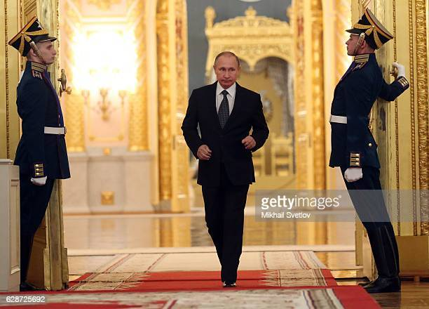 Russian President Vladimir Putin arrives to speak during a reception marking the Heroes of the Farherland's Day at the Grand Kremlin Palace on...