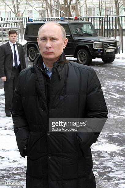 Russian President Vladimir Putin arrives to visit Sambo70 a Russian martial art and combat sport school March 13 2013 in Moscow Russia Putin and US...
