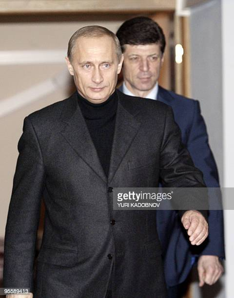 Russian President Vladimir Putin arrives with his campaign's chief Dimitri Kozak at his campaign headquarters near the Kremlin to speak to...