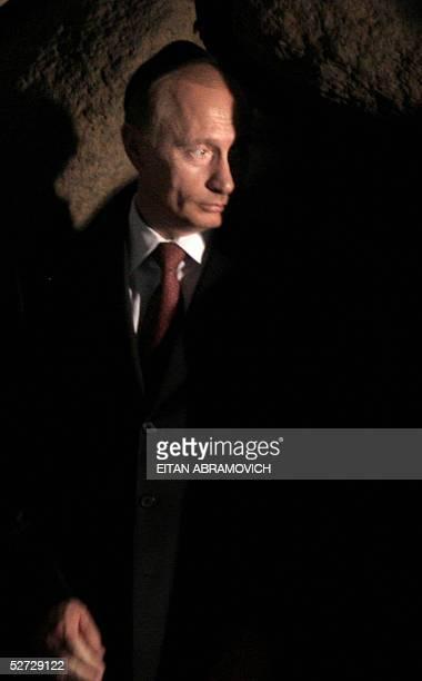 Russian President Vladimir Putin attends a ceremony at the Hall of Remembrance at Jerusalem's Yad Vashem Holocaust Memorial 28 April 2005 Putin said...