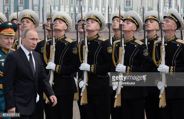Russian President Vladimir Putin attends a ceremony for Russia's Navy Day in Saint Petersburg on July 30 2017 President Vladimir Putin oversaw a...