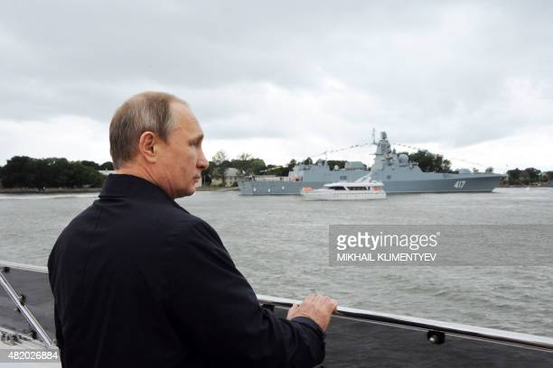 Russian President Vladimir Putin attends a ceremony marking Navy Day in Baltiysk in the Kaliningrad region on July 26 2015 AFP PHOTO / RIA NOVOSTI /...