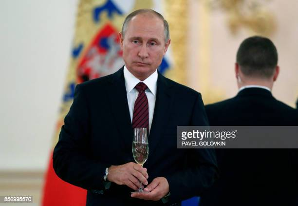 Russian President Vladimir Putin attends a ceremony of receiving diplomatic credentials from foreign ambassadors at the Kremlin in Moscow on October...