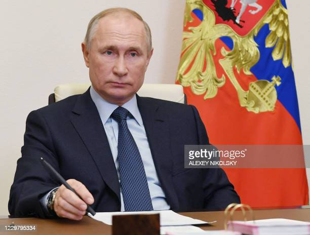 Russian President Vladimir Putin attends a ceremony to launch a new pharmaceutical substance large-scale production department at the...