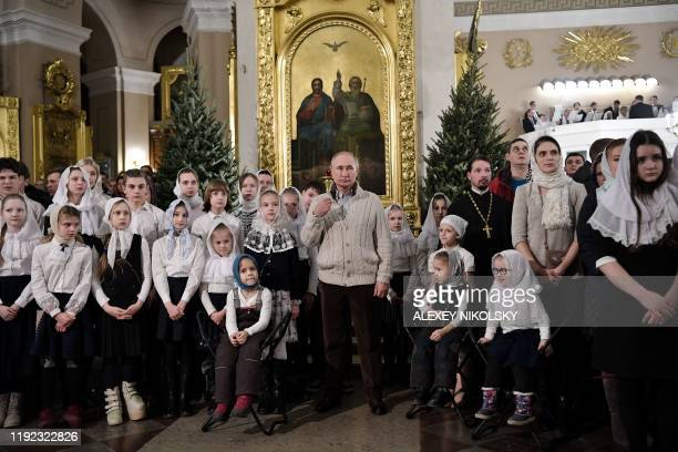 Russian President Vladimir Putin attends a Christmas liturgy at the Transfiguration Cathedral in Saint Petersburg early on January 7 2020 Orthodox...