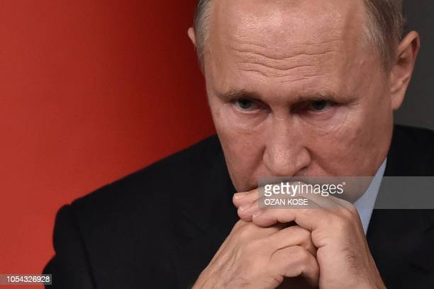 TOPSHOT Russian President Vladimir Putin attends a conference as part of a summit called to attempt to find a lasting political solution to the civil...