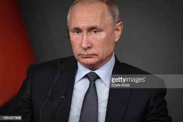 Russian President Vladimir Putin attends a conference as part of a summit called to attempt to find a lasting political solution to the civil war in...