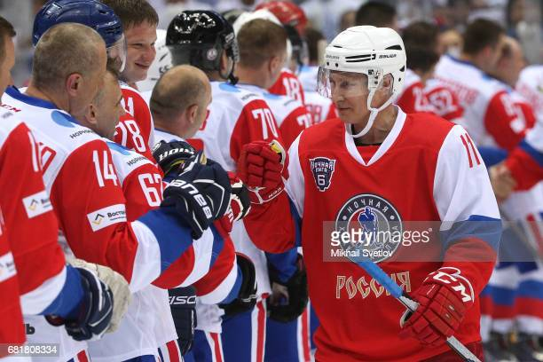 Russian President Vladimir Putin attends a gala match of the Night Hockey League teams at the Bolshoy ice arena on May 10 2017 in Sochi Russia Putin...