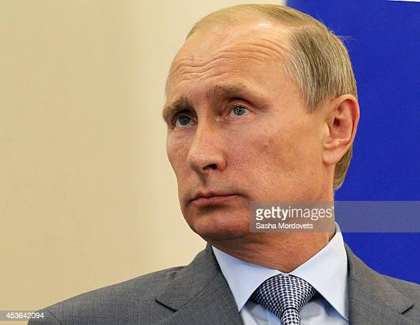 Russian President Vladimir Putin attends a joint press conference with Finnish President Sauli Niinisto at Bocharov Ruchey State Residence on August...