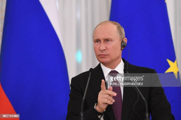 Russian President Vladimir Putin attends a joint press conference with his French counterpart following their talks at the Konstantin Palace in...