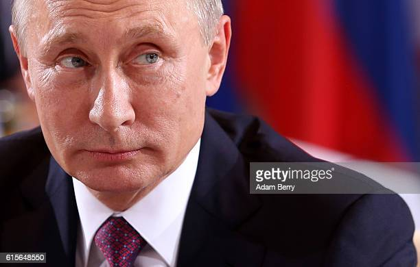Russian President Vladimir Putin attends a meeting to discuss the Ukrainian peace process at the German federal Chancellery on October 19, 2016 in...