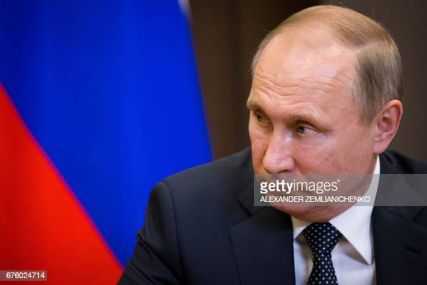 Russian President Vladimir Putin attends a meeting with Anatoly Bibilov the leader of Georgia's breakaway region of South Ossetia at the Bocharov...