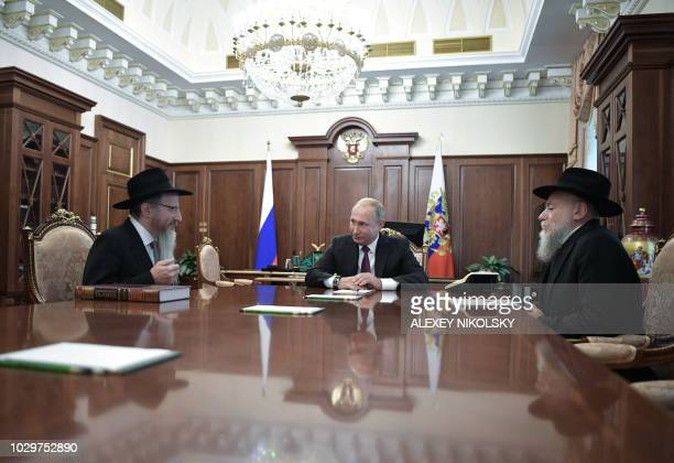 Russian President Vladimir Putin attends a meeting with Chief Rabbi of Russia Berel Lazar and President of the Federation of Jewish Communities...