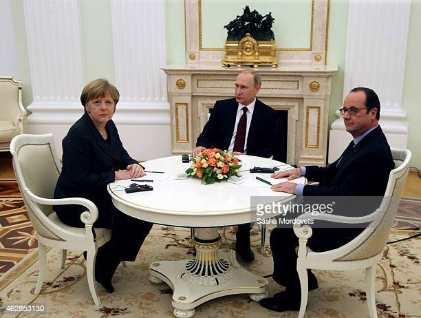 Russian President Vladimir Putin attends a meeting with German Chancellor Angela Merkel and French President Francois Hollande on February 6 2015 in...