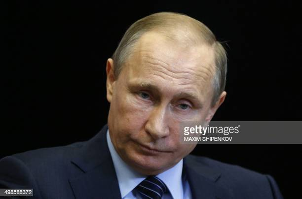 Russian President Vladimir Putin attends a meeting with Jordanian King Abdullah II at the Bocharov Ruchei state residence in Sochi on November 24...