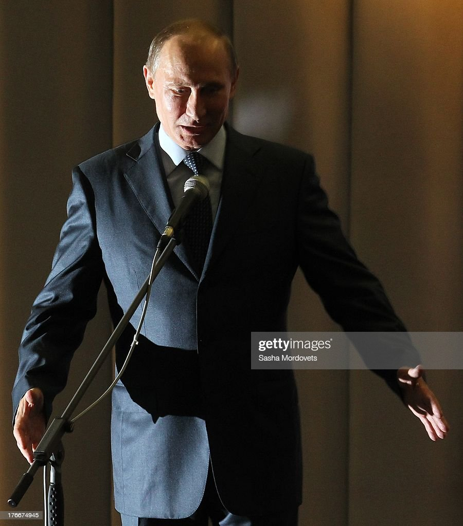 Russian President Vladimir Putin attends a meeting with members of Dinamo sport club at Bocharov Ruchey residence on August 17, 2013 in Sochi, Russia. Putin will spend time in his Black Sea resort residence for meetings.