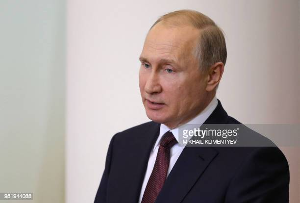 Russian President Vladimir Putin attends a meeting with members of the Legislator Council under the Russian Federal Assembly on the occasion of...