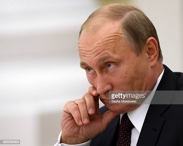 Russian President Vladimir Putin attends a meeting with newly elected governors of the Russian Federation at the Kremlin on September 17 2014 in...