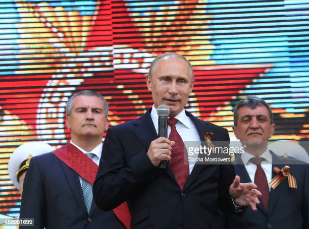 Russian President Vladimir Putin attends a military parade on May 9 2014 in Sevastopol Russia Putin is having a oneday visit to Crimea which marks...