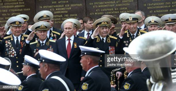 Russian President Vladimir Putin attends a military parade on May 9, 2014 in Sevastopol, Russia. Putin is having a one-day visit to Crimea which...