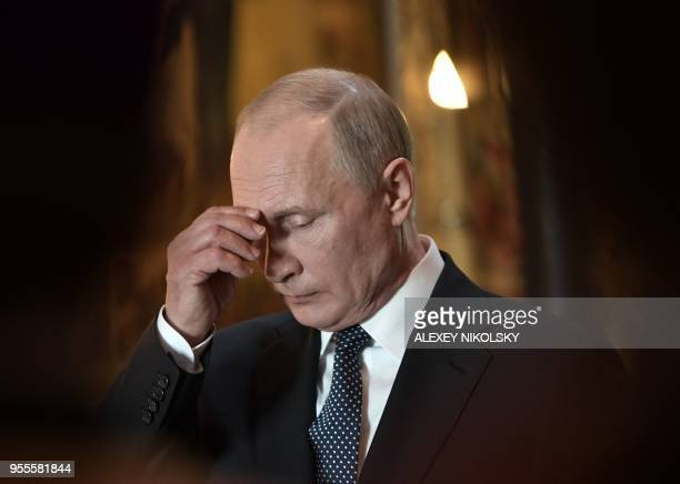 Russian President Vladimir Putin attends a prayer service following his inauguration ceremony at the Kremlin in Moscow on May 7 2018