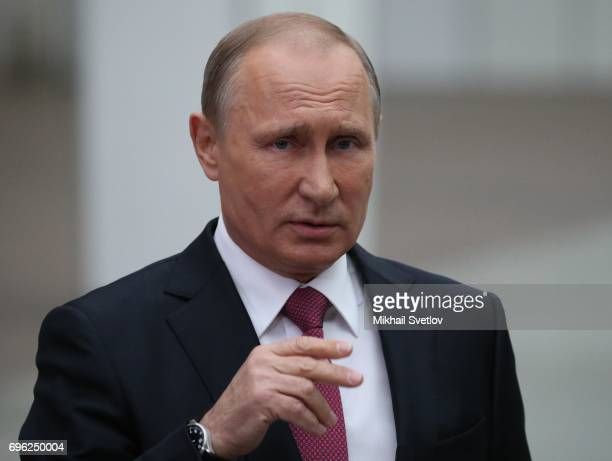 Russian President Vladimir Putin attends a press conference during his annual callinshow at press center in Gostiny dvor June 15 2017 in Moscow...