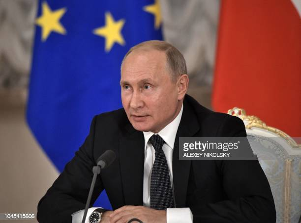 Russian President Vladimir Putin attends a press conference following a meeting with Austrian Chancellor at the State Hermitage Museum in Saint...