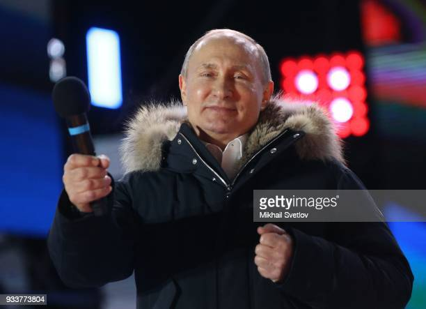 Russian President Vladimir Putin attends a rally of his supporters at Manezhnaya Square near the Moscow's Kremlin Russia March 18 2018 Vladimir Putin...