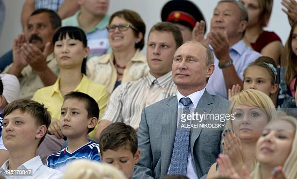 Russian President Vladimir Putin attends a sports festival for families with many children at the Adler Arena in the Russian Black Sea resort of...